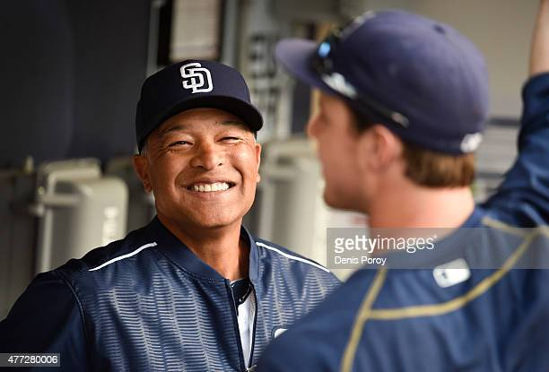 Interim manager Dave Roberts of the San Diego Padres talks with Wil Myers before a baseball game against the Oakland Athletics at Petco Park June 15...
