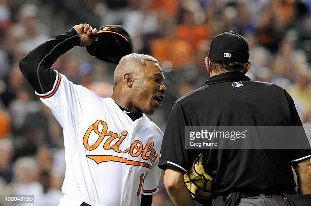 Interim Manager Juan Samuel of the Baltimore Orioles throws his hat after being ejected from the game by home plate umpire Bill Hohn during the...