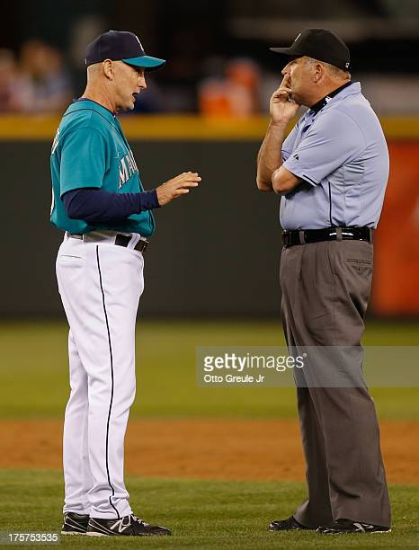 Interim manager Robby Thompson of the Seattle Mariners argues a call with second base umpire Dale Scott during the game against the Toronto Blue Jays...