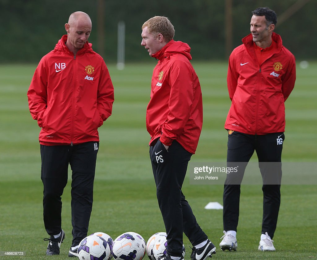 Interim Manager Ryan Giggs and First Team Coaches Paul Scholes and Nicky Butt of Manchester United in action during a first team training session at Aon Training Complex on April 25, 2014 in Manchester, England.