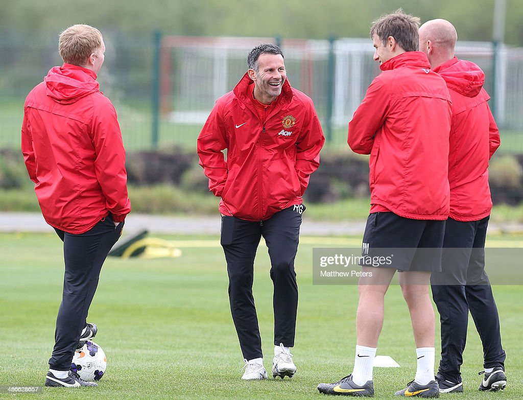 Interim Manager Ryan Giggs and First Team Coaches Paul Scholes, Phil Neville and Nicky Butt of Manchester United in action during a first team training session at Aon Training Complex on April 25, 2014 in Manchester, England.