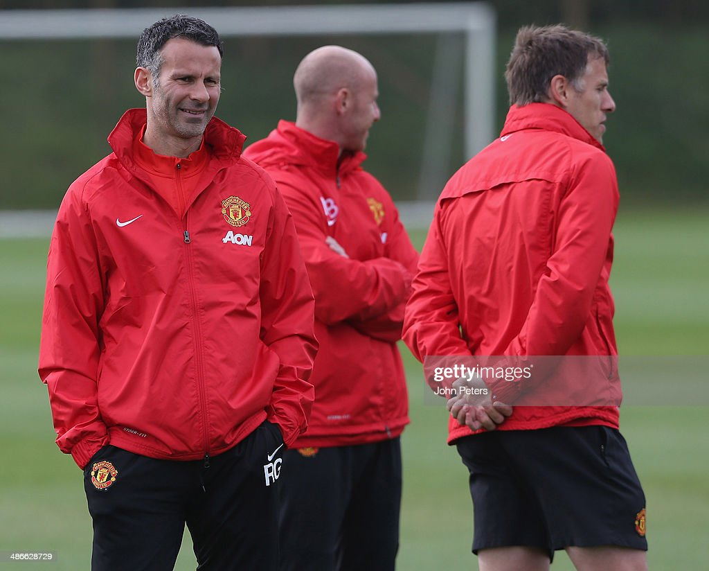 Interim Manager Ryan Giggs and First Team Coaches Phil Neville and Nicky Butt of Manchester United in action during a first team training session at Aon Training Complex on April 25, 2014 in Manchester, England.