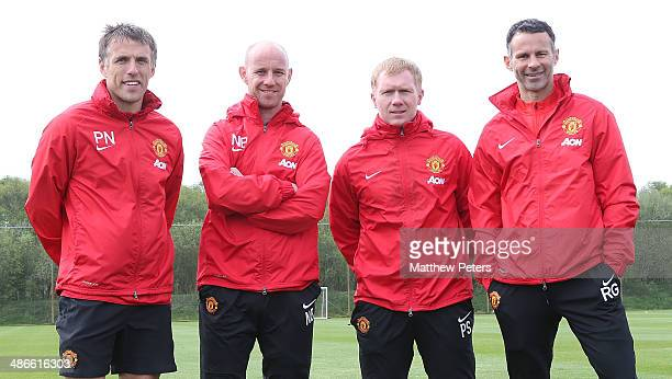 Interim Manager Ryan Giggs of Manchester United poses with his coaching staff of Phil Neville Nick Butt and Paul Scholes at Aon Training Complex on...