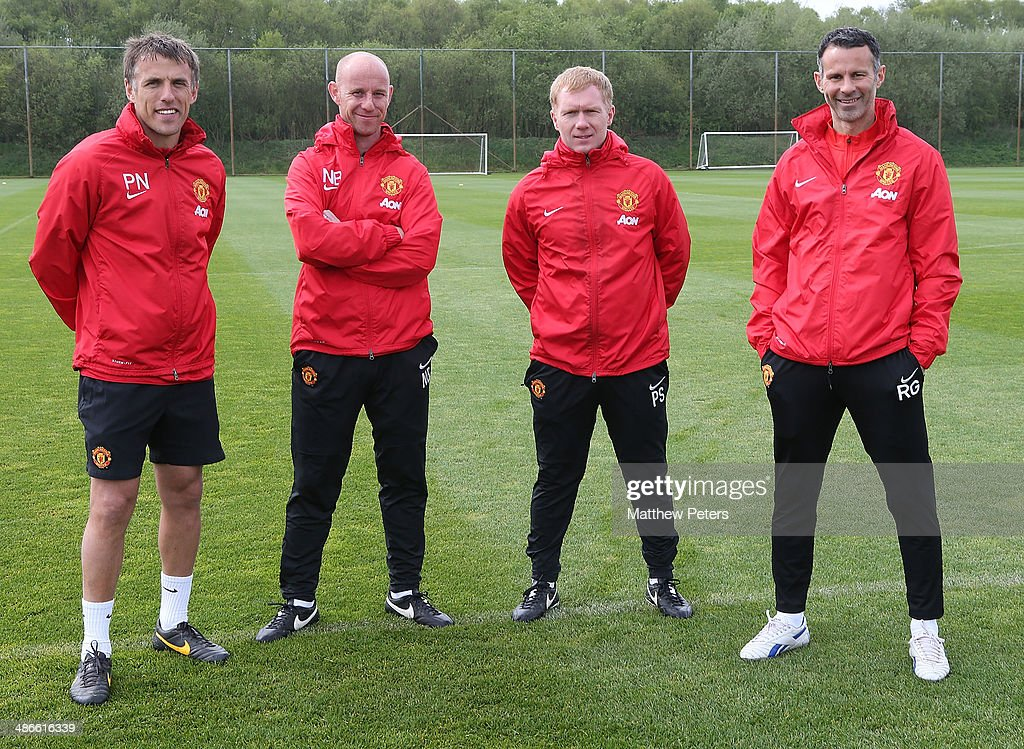 Interim Manager Ryan Giggs of Manchester United (R) poses with his coaching staff of (L-R) Phil Neville, Nick Butt and Paul Scholes at Aon Training Complex on April 25, 2014 in Manchester, England.