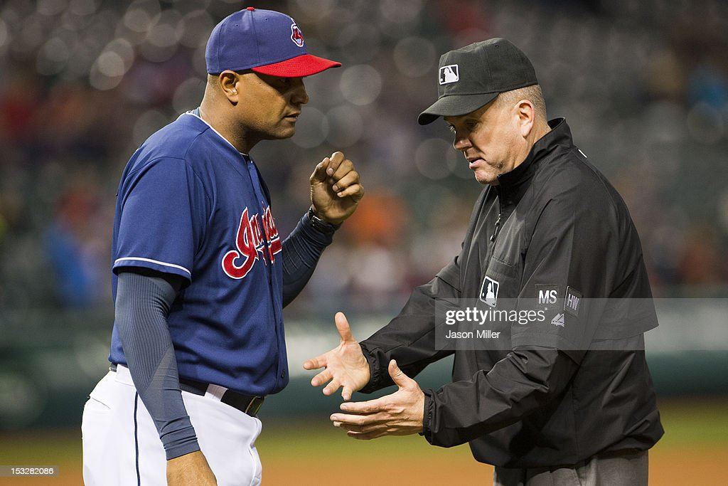 Interim Manager Sandy Alomar, Jr. #15 of the Cleveland Indians argues a call with first base umpire umpire Mike Everitt #57 during the eighth inning against the Chicago White Sox at Progressive Field on October 2, 2012 in Cleveland, Ohio.