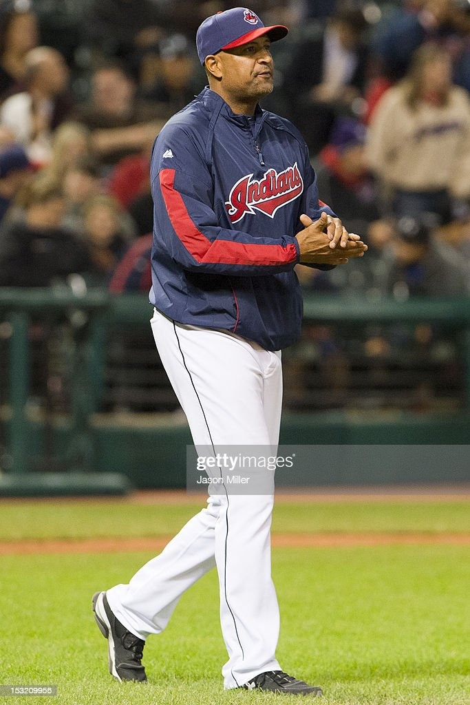 Interim Manager Sandy Alomar, Jr. #15 of the Cleveland Indians walks to the mound for a pitching change during the seventh inning against the Chicago White Sox at Progressive Field on October 1, 2012 in Cleveland, Ohio.