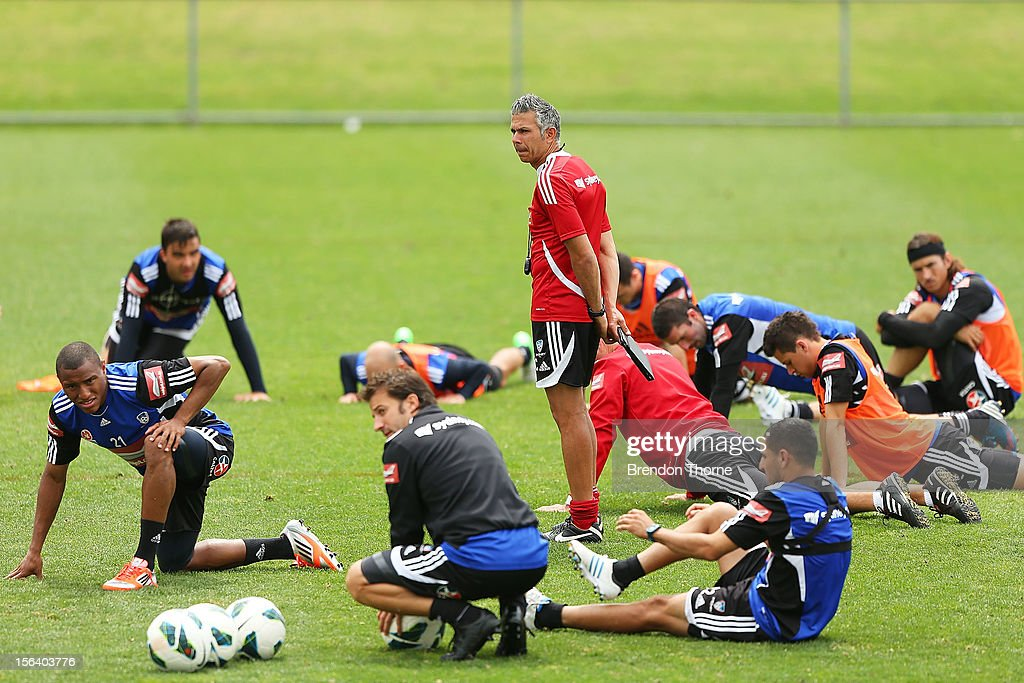 Interim Sydney FC coach Steve Corica watches his players warm down during a Sydney FC A-League training session at Macquarie Uni on November 15, 2012 in Sydney, Australia.