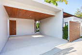 exterior design of white carport with wooden ceiling and wooden gated area