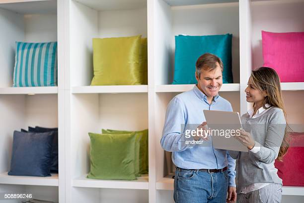Interior designer buying cushions at a furniture store