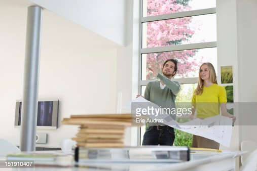 Interior designer discussing plan with a woman : Stock Photo