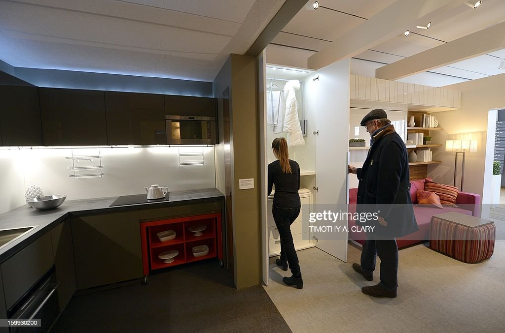 "Interior designer Julya Grundberg shows off a fully furnished 325-square-foot studio apartment during an exhibit displaying a transformable 'micro-unit' at the Museum of the City of New York January 23, 2013 during the opening of a new exhibition, 'Making Room: New Housing for New Yorkers' . New York City mayor Michael Bloomberg unveiled yesterday New York City's first ""micro-unit"" building will have apartments as small as 250 square feet."