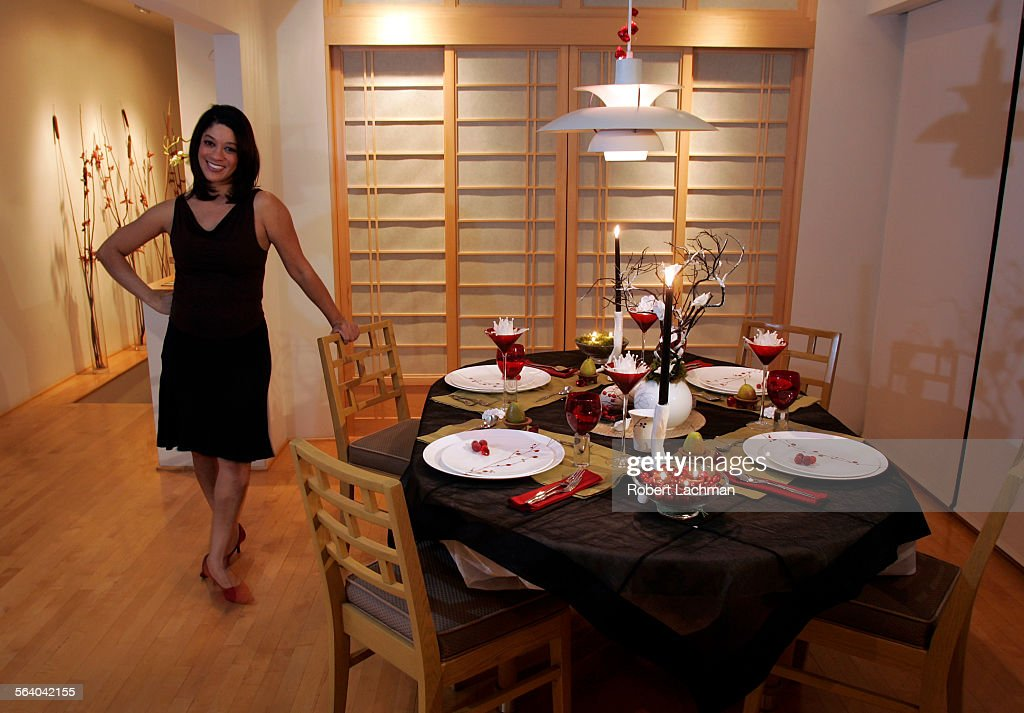 interior designer linda allen is photographed at her with dining table decorated in a holiday kwanzaa