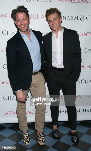 Interior designer Nate Berkus and Jeremiah Brent attend the Charm Chain Kaleidoscope Collection Launch at Up Down on April 23 2014 in New York City