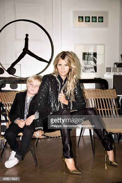 108009006 Interior designer Sarah Lavoine and son Roman are photographed for Madame Figaro on October 11 2013 in Paris France Sarah Jacket blouse and...
