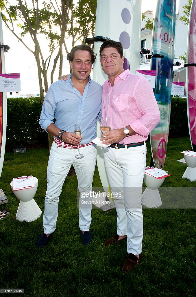 Interior designer <a gi-track='captionPersonalityLinkClicked' href=/galleries/search?phrase=Thom+Filicia&family=editorial&specificpeople=210619 ng-click='$event.stopPropagation()'>Thom Filicia</a> and Publicist Greg Calejo attend the 2nd annual Paddle & Party for Pink on August 17, 2013 in Sag Harbor, New York.