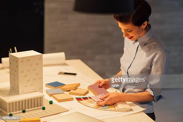Interior Designer Working Late In Her Office.