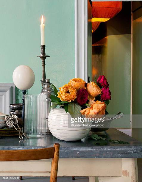 Interior designers Emiliano Salci and Britt Moran of Dimore are photographed for Madame Figaro on October 15 2015 in Milan Italy On an old kitchen...