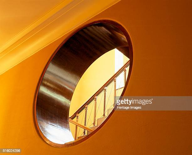 Interior detail Eltham Palace Greenwich London c2000s View from the corridor near the entrance hall of part of the staircase seen though the porthole...