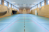 Empty european gym class for school sports no people. In the netherlands the teenagers learn several different sports on high school. I took this photo of a gym or gymnasium on the secondary school in