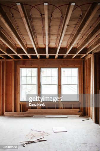 Interior framework of house under construction : Stock Photo