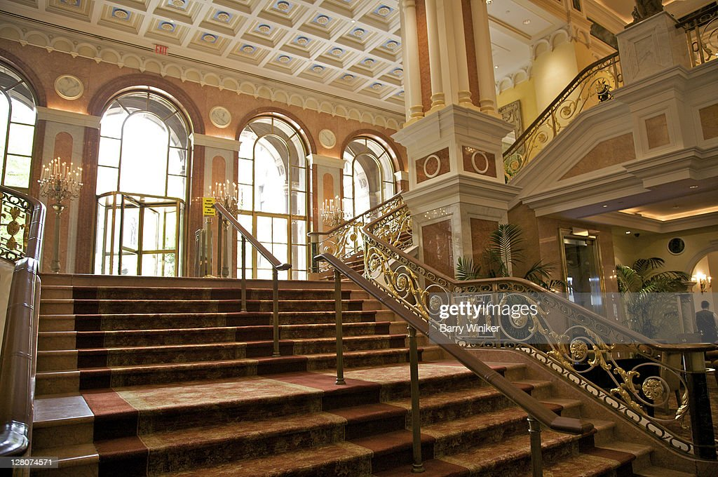 Interior, grand staircase at the New York Palace, New York, NY, Luxury hotel at 50th and Madison Avenue built atop Villard Houses by Emery Roth and Sons, for Harry Helmsley, 1981 : Stock Photo