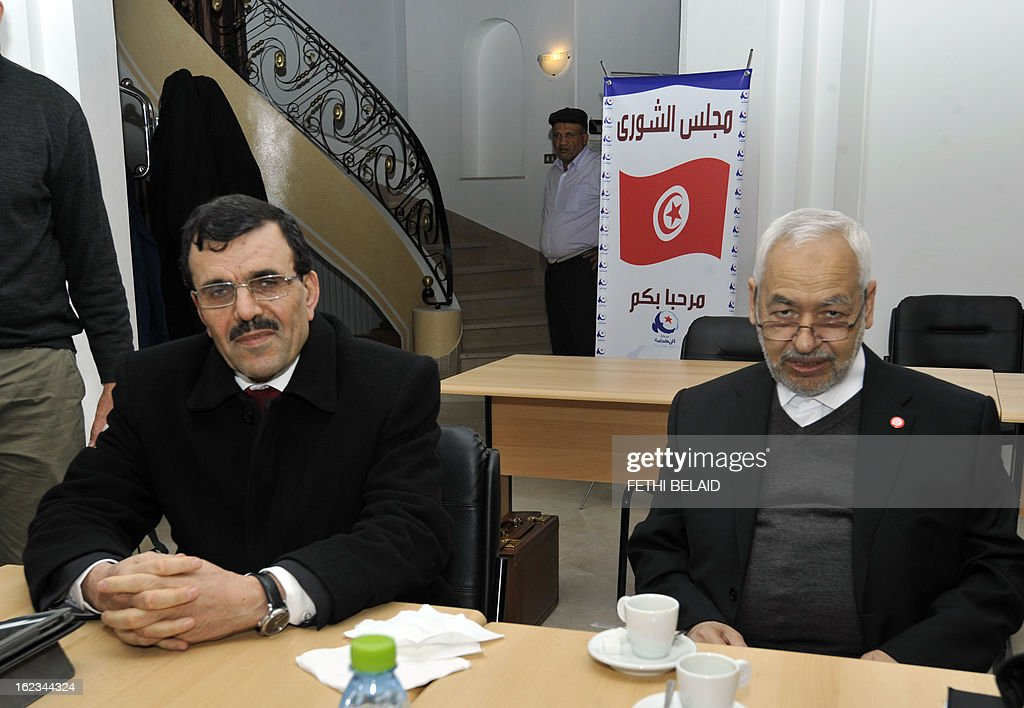 Interior Minister Ali Larayedh and Ennahda ruling party's leader Rached Ghannouchi pose before a meeting at the party's headquarters on February 22, 2013 in Tunis. Ennahda has tapped Larayedh as its candidate to replace Prime Minister Hamadi Jebali, who resigned this week amid a major political crisis, the party said.