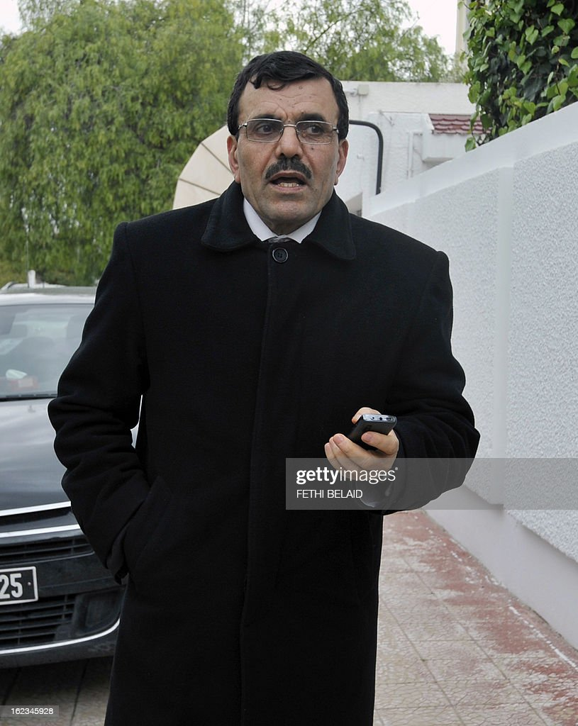 Interior Minister Ali Larayedh holds his phone as he arrives for a meeting at the Ennahda ruling party's headquarters on February 22, 2013 in Tunis. Ennahda has tapped Larayedh as its candidate to replace Prime Minister Hamadi Jebali, who resigned this week amid a major political crisis, the party said.