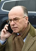 Interior minister Bernard Cazeneuve gives a phone call on January 19 2016 in SaintAstier following their visit at the Gendarmerie national training...