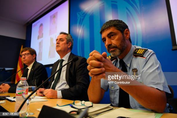 Interior Minister for the Catalan government Joaquim Forn looks on past Josep Lluis Trapero chief of the Catalan regional police 'Mossos D'Esquadra'...