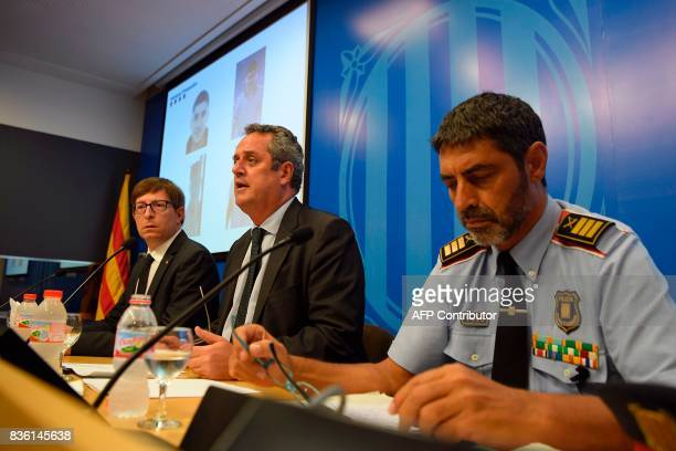 Interior Minister for the Catalan government Joaquim Forn speaks past Josep Lluis Trapero chief of the Catalan regional police 'Mossos D'Esquadra'...