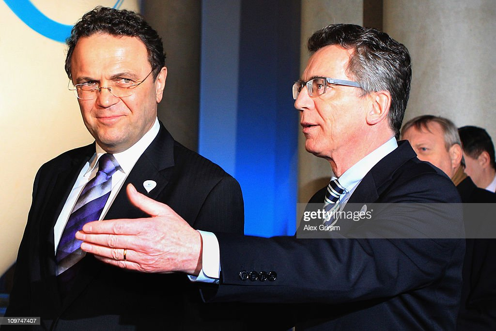 Interior Minister Hans-Peter Friedrich (L) and Defence Minister Thomas de Maiziere arrive for a reception at the Residenz on March 3, 2011 in Munich, Germany. The IOC's Evaluation Commission will visit Munich's Olympic venues and sites associated with their 2018 bid.