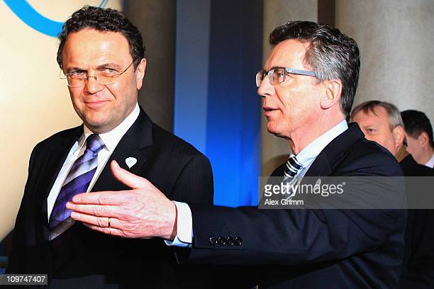 Interior Minister HansPeter Friedrich and Defence Minister Thomas de Maiziere arrive for a reception at the Residenz on March 3 2011 in Munich...