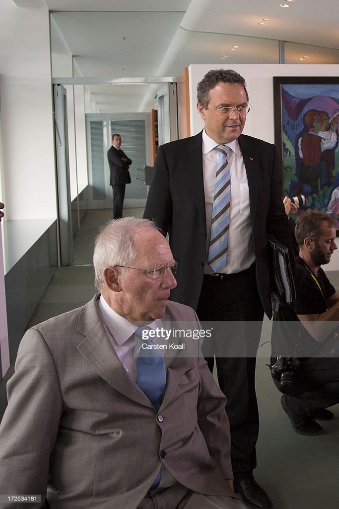 Interior Minister <a gi-track='captionPersonalityLinkClicked' href=/galleries/search?phrase=Hans-Peter+Friedrich&family=editorial&specificpeople=7528072 ng-click='$event.stopPropagation()'>Hans-Peter Friedrich</a> (R) and German Finance Minister Wolfgang Schaeuble (L) attend the weekly cabinet meeting at the Chancellery (Bundeskanzleramt) on July 3, 2013 in Berlin, Germany.