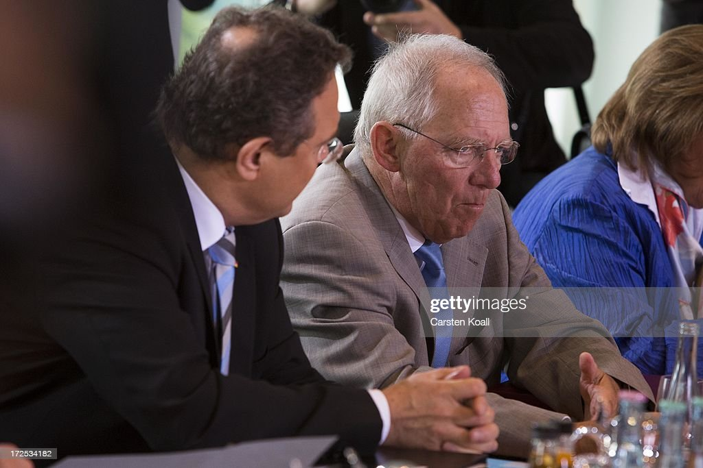 Interior Minister Hans-Peter Friedrich (L) and German Finance Minister Wolfgang Schaeuble (R) attend the weekly cabinet meeting at the Chancellery (Bundeskanzleramt) on July 3, 2013 in Berlin, Germany.