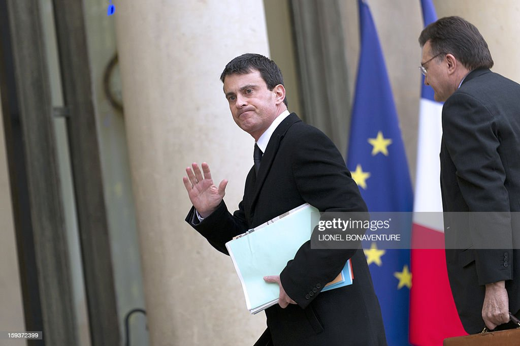 Interior minister Manuel Valls (L) and Defence general secretary Francis Delon arrive at the Elysee palace on January 12, 2013 in Paris to take part in a Defence council focused on the situation in Mali. France has asked the United Nations to 'accelerate' implementation of a resolution that enables the deployment of an international force to Mali. AFP PHOTO LIONEL BONAVENTURE