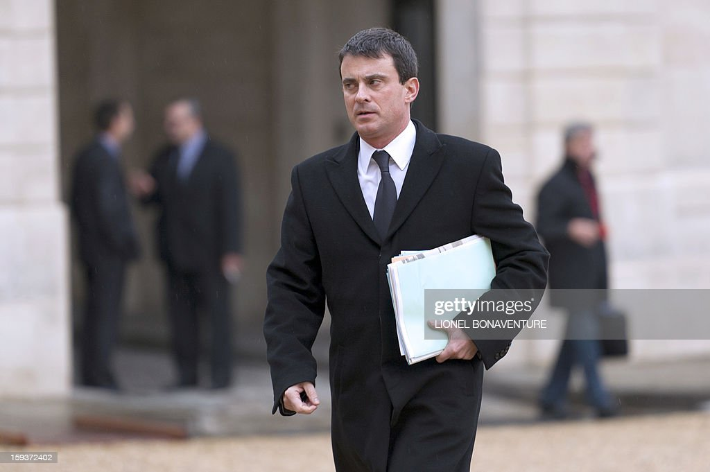 Interior minister Manuel Valls arrives at the Elysee palace on January 12, 2013 in Paris to take part in a Defence council focused on the situation in Mali. France has asked the United Nations to 'accelerate' implementation of a resolution that enables the deployment of an international force to Mali. AFP PHOTO LIONEL BONAVENTURE