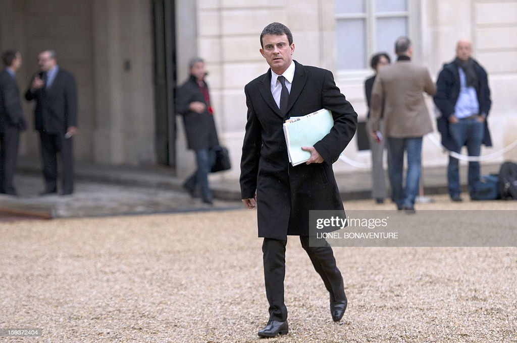 Interior minister Manuel Valls arrives at the Elysee palace on January 12, 2013 in Paris to take part in a Defence council focused on the situation in Mali. France has asked the United Nations to 'accelerate' implementation of a resolution that enables the deployment of an international force to Mali.