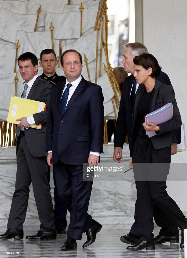 Interior Minister, Manuel Valls, French President Francois Hollande, Prime Minister, Jean-Marc Ayrault and Minister for Women's Rights and Government Spokesperson, Najat Vallaud-Belkacem leave after the weekly cabinet meeting at the Elysee palace on March 19, 2014 in Paris, France.