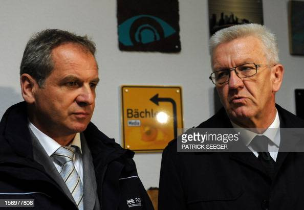 Interior minister of BadenWuerttemberg Reinhold Gall and Prime Minister of BadenWuerttemberg Winfried Kretschmann attend a press conference on the...