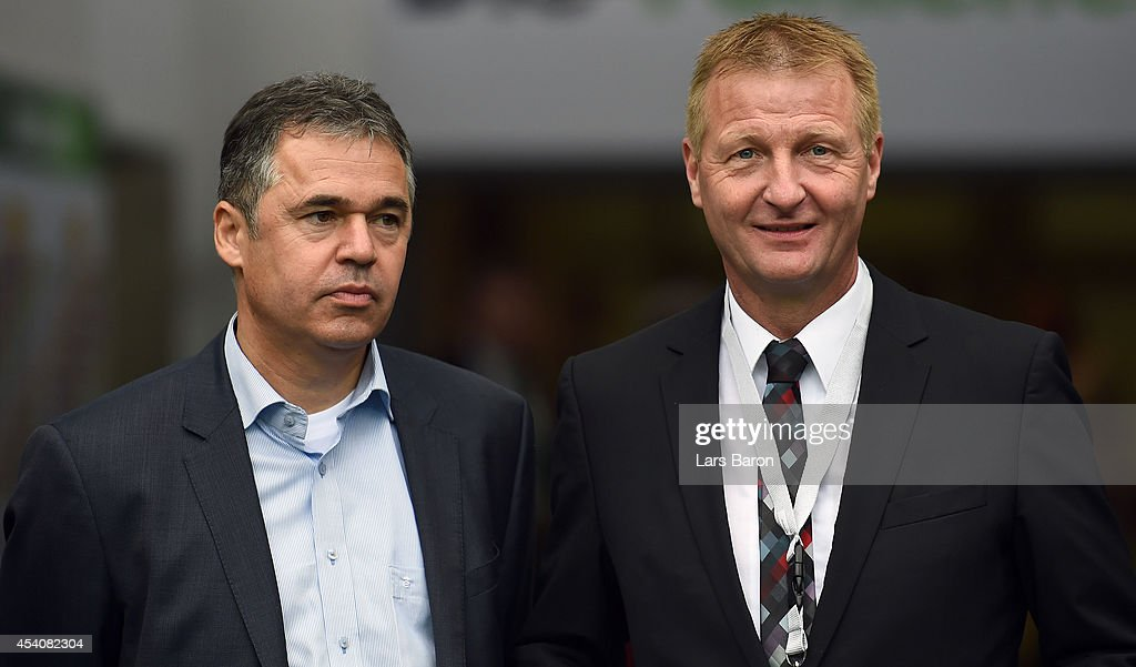 Interior Minister of North Rhine Westphalia Ralf Jaeger (R) is seen with Andreas Rettig, Managing director of DFL, during the Bundesliga match between Borussia Moenchengladbach and VfB Stuttgart at Borussia Park Stadium on August 24, 2014 in Moenchengladbach, Germany.