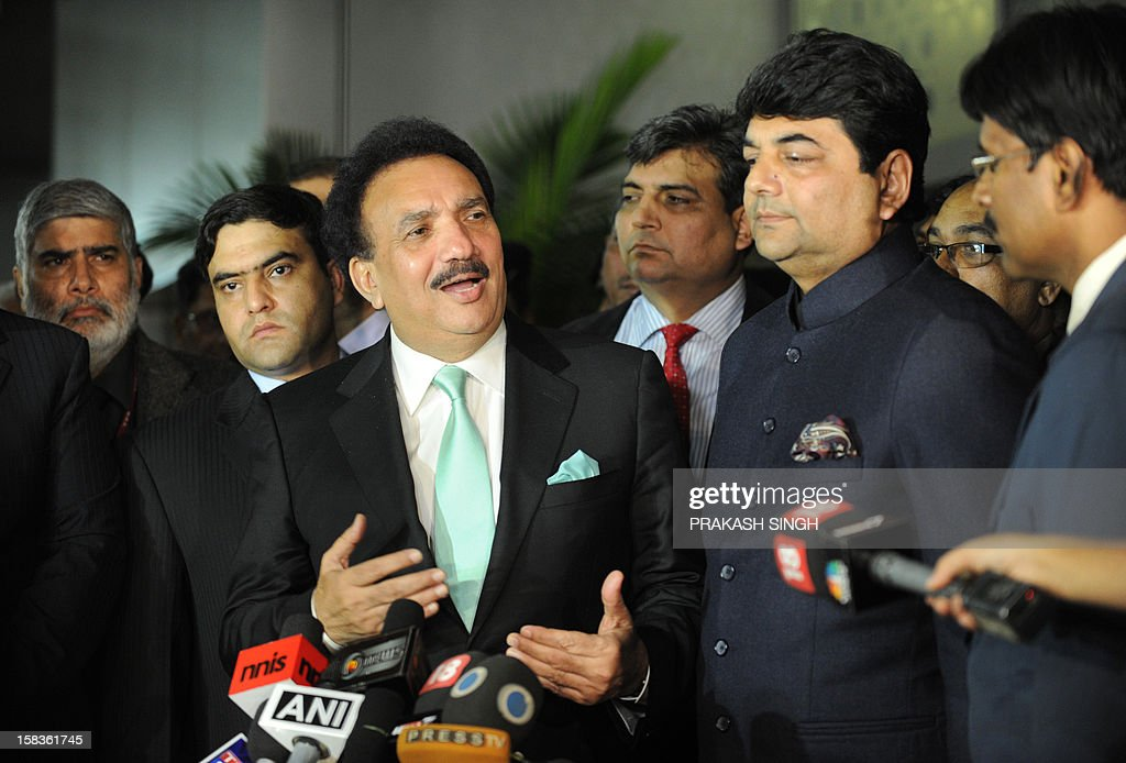 Interior Minister of Pakistan Rehman Malik (C) gestures while speaking as Kunwar Ratanjit Pratap Narain Singh (2R), Indian Minister of State in Home Affairs, looks on after Malik arrived at an Indian Air Force station in New Delhi on December 14, 2012. Pakistan's interior minister flew to India to launch a new agreement aimed at lowering hurdles in cross-border travel between the two nuclear-armed rival countries, officials said. AFP PHOTO/ Prakash SINGH