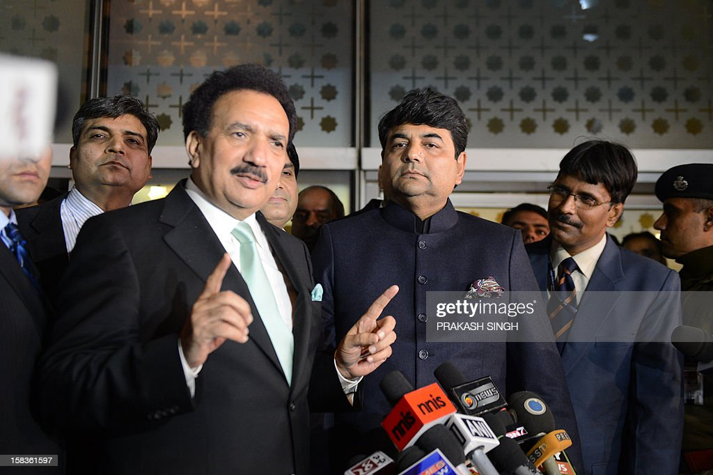 Interior Minister of Pakistan Rehman Malik (L) gestures while speaking after arriving at an Indian Air Force station as Indian Kunwar Ratanjit Pratap Narain Singh (2R), Minister of State in Home Affairs looks on in New Delhi on December 14, 2012. Pakistan's interior minister flew to India to launch a new agreement aimed at lowering hurdles in cross-border travel between the two nuclear-armed rival countries, officials said. AFP PHOTO/ Prakash SINGH