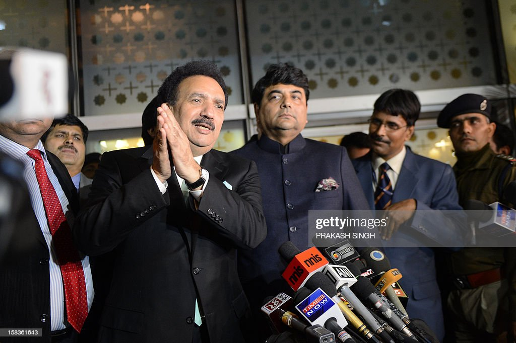 Interior Minister of Pakistan Rehman Malik (L) gestures while speaking after arriving at an Indian Air Force station as Kunwar Ratanjit Pratap Narain Singh (3R), Indian Minister of State in Home Affairs, looks on in New Delhi on December 14, 2012. Pakistan's interior minister flew to India to launch a new agreement aimed at lowering hurdles in cross-border travel between the two nuclear-armed rival countries, officials said. AFP PHOTO/ Prakash SINGH