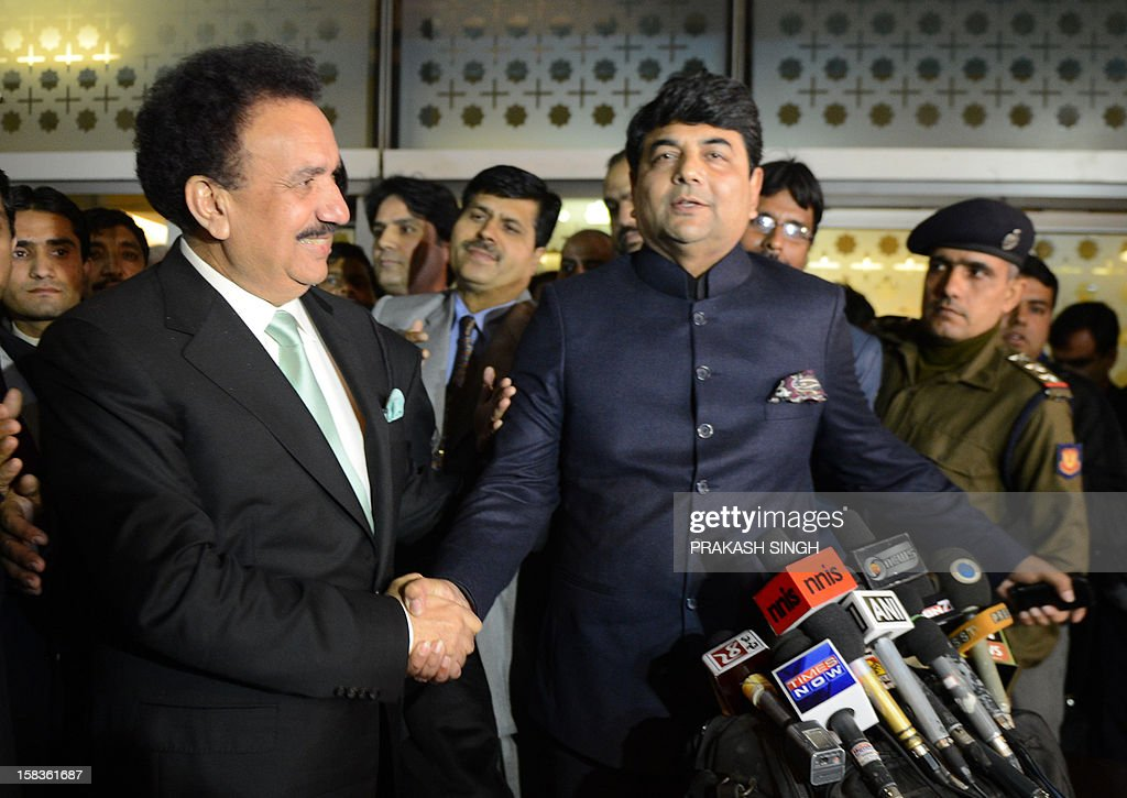 Interior Minister of Pakistan Rehman Malik (L) shakes hands with Kunwar Ratanjit Pratap Narain Singh, Indian Minister of State in Home Affairs, after arriving at an Indian Air Force station in New Delhi on December 14, 2012. Pakistan's interior minister flew to India to launch a new agreement aimed at lowering hurdles in cross-border travel between the two nuclear-armed rival countries, officials said. AFP PHOTO/ Prakash SINGH