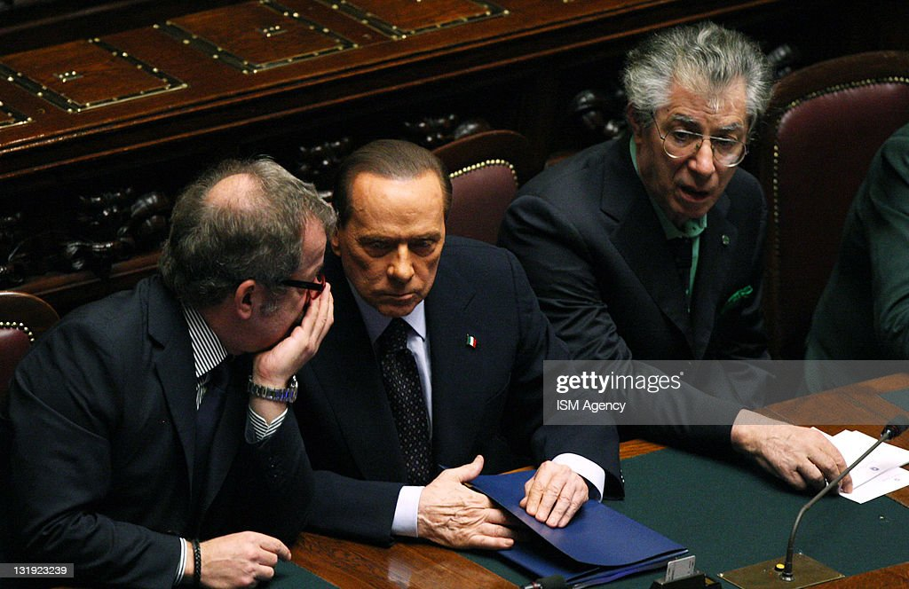 Interior Minister <a gi-track='captionPersonalityLinkClicked' href=/galleries/search?phrase=Roberto+Maroni&family=editorial&specificpeople=665299 ng-click='$event.stopPropagation()'>Roberto Maroni</a>, Italian Prime Minister <a gi-track='captionPersonalityLinkClicked' href=/galleries/search?phrase=Silvio+Berlusconi&family=editorial&specificpeople=201842 ng-click='$event.stopPropagation()'>Silvio Berlusconi</a> and Reform Minister <a gi-track='captionPersonalityLinkClicked' href=/galleries/search?phrase=Umberto+Bossi&family=editorial&specificpeople=613296 ng-click='$event.stopPropagation()'>Umberto Bossi</a> attend a vote at the Chamber of Deputies on November 8, 2011 in Rome, Italy. Mr. Berlusconi is today facing his 54th vote of confidence in parliament since his election as Prime Minister in 2008. Pressure is mounting on the Italian PM amidst fears that Italy could become the next victim of the eurozone debt crisis with the government's borrowing costs rising to a new record of 6.74% on Tuesday.