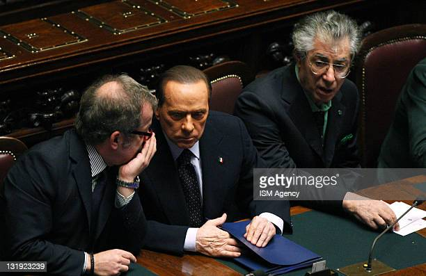 Interior Minister Roberto Maroni Italian Prime Minister Silvio Berlusconi and Reform Minister Umberto Bossi attend a vote at the Chamber of Deputies...