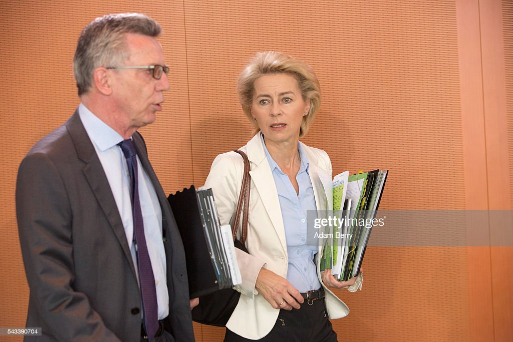 Interior Minister <a gi-track='captionPersonalityLinkClicked' href=/galleries/search?phrase=Thomas+de+Maiziere&family=editorial&specificpeople=618845 ng-click='$event.stopPropagation()'>Thomas de Maiziere</a> (CDU) (L) and Defense Minister <a gi-track='captionPersonalityLinkClicked' href=/galleries/search?phrase=Ursula+von+der+Leyen&family=editorial&specificpeople=4249207 ng-click='$event.stopPropagation()'>Ursula von der Leyen</a> (CDU) arrive for the weekly German federal Cabinet meeting on June 28, 2016 in Berlin, Germany. High on the meeting's agenda was discussion of policies regarding country's central intelligence agency (Bundesnachrichtendienst, or BND) abroad.