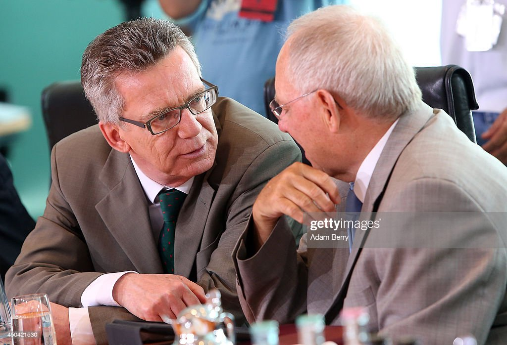 Interior Minister <a gi-track='captionPersonalityLinkClicked' href=/galleries/search?phrase=Thomas+de+Maiziere&family=editorial&specificpeople=618845 ng-click='$event.stopPropagation()'>Thomas de Maiziere</a> (CDU) (L) and Finance Minister Wolfgang Schaeuble (CDU) arrive for the weekly German federal Cabinet meeting on June 11, 2014 in Berlin, Germany. High on the meeting's agenda was discussion over the country's arms export policies.