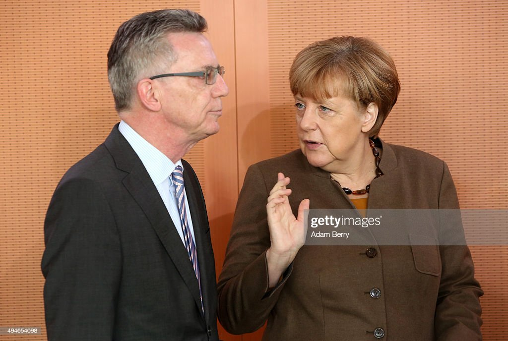 Interior Minister Thomas de Maiziere (CDU) (L) and German Chancellor Angela Merkel (CDU) arrive for the weekly German federal Cabinet meeting on October 28, 2015 in Berlin, Germany. High on the meeting's agenda was discussion of the country's military presence abroad.
