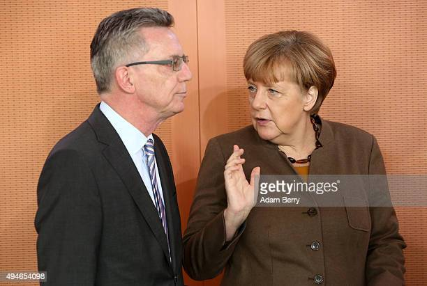 Interior Minister Thomas de Maiziere and German Chancellor Angela Merkel arrive for the weekly German federal Cabinet meeting on October 28 2015 in...